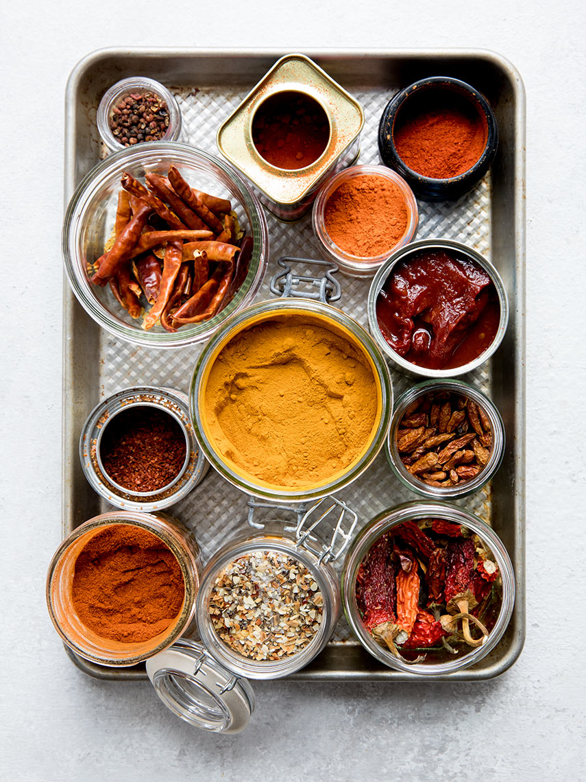 Tray of turmeric, paprika, peppers and other spices